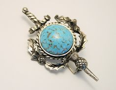 Scottish brooch. Sword and thistle brooch. Turquoise glass brooch by chicvintageboutique on Etsy