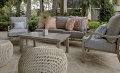 The Sitting Room Studio. Outdoor seating area. Love the woven swivel stools for extra seating and texture.