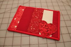 Red Week - Postcard - Always Expect Moore binding tute for postcard