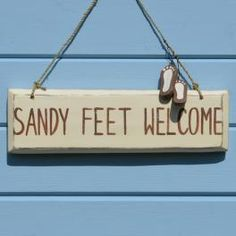 sandy feet welcome sign - click to view