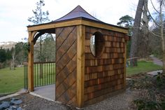 Copper roofed garden room, created for RHS Rosemoor in Devon.  This photograph illustrates the sides clad in both copper and cedar shingles.  It also features the copper-lined porthole.