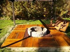 Floating pallet deck, pallet swing bench, and fire pit all homemade.