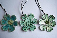 Enamelled copper pendants, by Ashley Heminway.