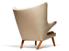 Hans J. Wegner Papa Bear wing-back armchair (1951) with exposed arms and tapered dowel legs. Originally made by A.P. Stolen, Denmark. / 1stDibs