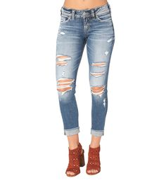 Suki Skinny Crop Medium Wash - the ultimate curve-flattering jean, Suki features a comfortable mid rise and relaxed fit through the hip and thigh with hand sanding and destroyed details.