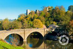 Dinham Bridge over the River Teme and #Ludlow Castle seen in autumn, Ludlow, #Shropshire, England.