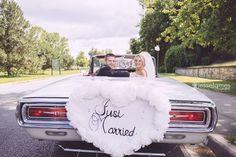 Bride and groom in old vintage car