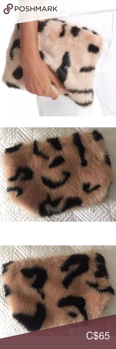 Shrimps Hubbard Faux Fur Zip Clutch Pink Black This clutch is new without tags (the piece of plastic that the tag was attached to is still intact). It is in excellent condition, but there are some areas where the faux fur is unruly, not as full or has slightly flattened. There are some light markings near the zipper. Shrimps Bags Clutches & Wristlets Pink Black, Wristlets, Plus Fashion, Fashion Tips, Clutches, Faux Fur, Plastic, Zipper, Tags