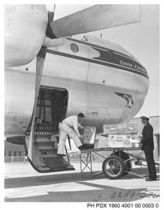 Pan American Boeing 377 receives cargo