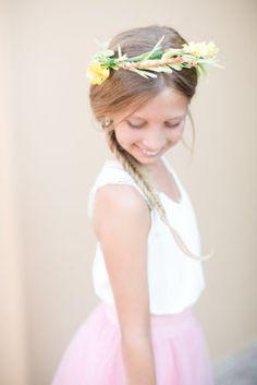 Adorable flower girl with a fishtail braid & a pretty crown: http://www.stylemepretty.com/arizona-weddings/paradise-valley/2015/08/26/rustic-romantic-arizona-summer-wedding/   Photography: Amy & Jordan - http://amyandjordan.com/