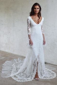 Handmade from a unique stretch French lace with a captivating silhouette, the Francis gown is for the woman who is elegant, yet free-spirited.