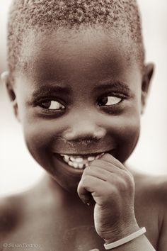 Himba boy (Namibia) was fascinated with the photographer's camera (photo by Susan Portnoy)