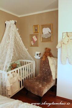 sweet nursery corner- very nice, and that corner in the master bedroom is a perfect space as a nursery corner!