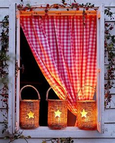checkered curtains and luminaries - so warm and welcoming