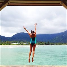 Our own Ashley Johnston in Seea's Sea Glass One Piece Riviera jumping off the Hanalei Pier! Happy Aloha Friday!