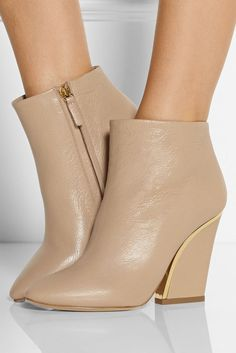 CHLOÉ Gold-trimmed Textured-leather Ankle Boots    $1211 BUY ➜ http://shoespost.com/chloe-gold-trimmed-textured-leather-ankle-boots/ Chloé's textured-leather ankle boots are trimmed with gold for an utterly luxurious look. Designed with a sleek pointed toe and chunky block heel, this pair is clean, modern and endlessly versatile. Wear yours with an all-white outfit, or team them with sleek denim at the weekend.      ...