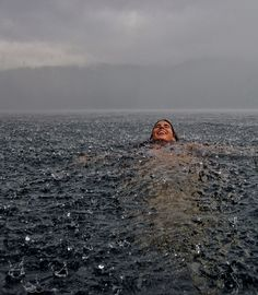 Swimming in the Rain - Lago Caburgua, Chile. Photo by Camila Massu
