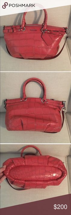 Coral Coach Purse Beautiful Coach Purse. Consolidating my sister's Posh closet with mine; please see purse details above. If you have more questions, please contact me. Reasonable offers accepted. Coach Bags