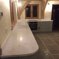 Check out this kitchen in Oxford installed with our Urban Quartz Carrera. This beautiful worktop is a genuine Italian design, white Quartz with subtle grey marbling. View this product: Carrera Get a quote: Quote me Carrara Quartz, Quartz Rock, Engineered Stone, White Quartz, Carrera, Granite, Stones, Urban, Kitchen