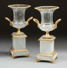 A PAIR OF FRENCH BACCARAT-TYPE CUT-GLASS AND GILT BRONZE MOUNTED URNS ON BASES, 20th century.