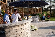Stone Oasis Curved Bar serves as the platform for entertaining family and friends.