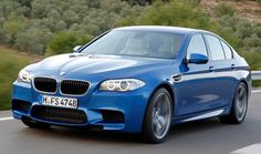 A three-quarter front view of a blue BMW M5 in action.   | Carjackd.tv    #carjackdtv