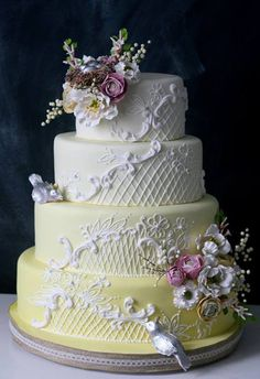ombre yellow to white wedding cake with flowers as decoration
