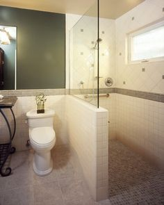 Walk In Shower for the basement bathroom. This option reduces the amount of glass that needs to be installed.