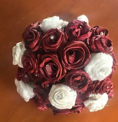 Burgandy flax roses with cream lace roses. These were made from the offcuts of the brides gown