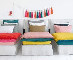 Les pompons + les couettes assorties (dessus de lit ?)