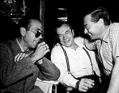 "Humphrey Bogart, Gordon Carveth, and Peter Lorre on the set of ""Confidential Agent,"" circa 1945."