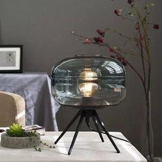 ALONDRA Table Lamp — Best Goodie Shop #ALONDRA #tablelampshade #tablelampdesign #interiorlighting #bestgoodieshop #lightsdecorations #roomlights #nightstandlamps #lampdecoration #lampideas #lampdecor #tablelightingdesign #tablelighting #desklampideas Bedside Table Lamps, Desk Lamp, Round Desk, Alondra, Light Art, Light Bulb, Glass Domes, Vintage Lighting, Glass Table