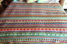 This is a blanket that is made with many different stitch patterns so it doesn't get boring! Each row is a different pattern, a good way to learn new stitches and play with colour.