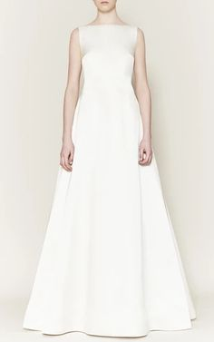 This **Emilia Wickstead Bridal** dress features a bateau neckline and fitted silhoueete.
