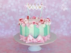 2 tones Tiffany blue stripes accent with variety of hand made sugar flowers : rose buds ,hydrangea, daisies , petal flowers different shades of pink ,  Design inspired from :cotton & crumbs  https://www.facebook.com/maryam.cakes