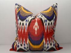 Ikat cushion / pillow with red, lilac , yellow and white