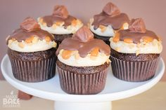 Snickers Cupcakes Snickers Cupcakes, Butterfinger Cupcakes, Chocolate Cupcakes, Caramel Bits, Hershey Cocoa, Cupcake Pans, Filled Cupcakes, Melting Chocolate, Just Desserts