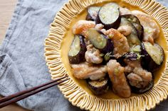 Eggplant, chicken thigh meat, onions dusted in potato starch and pan fried. Mix chicken bouillon, mirin, sake, ginger, garlic and soy sauce and pour over chicken and continue cooking until sauce is thickened.