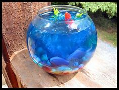 Fish Bowl Jello! from Food.com: This is a huge hit! It looks so cool when completed!! Its a bit of work, but definitely worth it :-) If anyone makes this and takes a photo, please do post it!!! Prep time really varies.. so please make sure you set aside enough time to make this!!! Cook time is time to chill total. Like I said times really vary so please set aside some time. Requires 1 goldfish bowl (new is preferred hehe.. otherwise.. pleaaaaaaase clean the old one! haha)