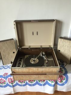 A suitcase + music and speakers = very cool vintage portable record player.