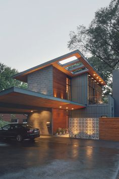 """boxes"" to create a house. Little mid-century vibe. Concrete and wood."