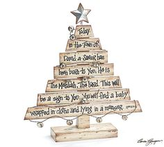 Hand-painted wood plank Christmas tree with Christmas Story printed on the planks. A distressed metal star on spring at top of tree. Wire with bells attached and flows over tree for accents. Tree is h