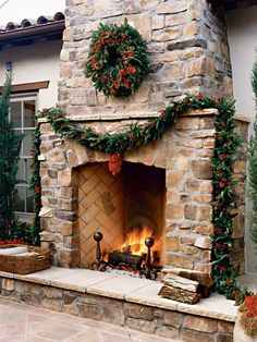 outdoor fireplace decorated with garland and wreath