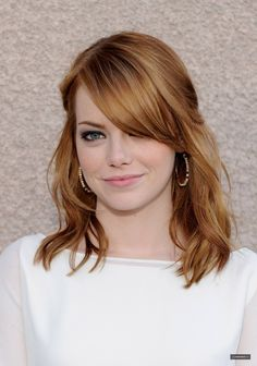 shoulder length. looks so cute on her! makes me wish I had red hair