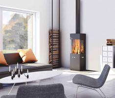 - Holz-kaminofen / modern / 3 sichtseiten / metall by RAIS Contemporary Wood Burning Stoves, Modern Stoves, Home Fireplace, Fireplace Design, Fireplaces, Living Tv, Home And Living, Modern Living, Indoor Wood Stove