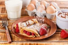 Fruit filled pancakes with powdered sugar Fruit Pancakes, Waffles, Drink Photo, Powdered Sugar, Food And Drink, Breakfast, Ethnic Recipes, Graphics, Check