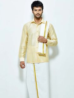 Classic cream color raw silk shirt paired with white color cotton dhoti and angavastram. Item Code : SCU13610-1 http://www.bharatplaza.com/new-arrivals/south-indian-mens-wear.html