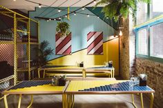 Techné designed custom furniture, including the booths, banquettes, and tables, that reference picnic and park furniture and benches for this restaurant.