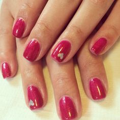 Raspberry pink sparkly gel polish nails with silver heart.