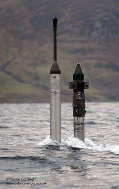 The periscope of Royal Navy submarine HMS Talent pokes above the cold waters ofKyle of Lochalsh, Scotland during surfacing drills in the in December 2009.I see you lol